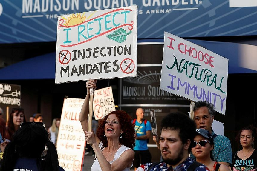 Anti-vaccine protesters outside Madison Square Garden ahead of a show by rock band Foo Fighters, which required proof of vaccination to enter, in New York City in June.