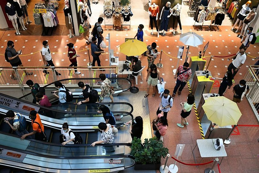"""People at Jurong Point shopping mall last week. According to one expert, while it is possible that new variants with even better transmissibility may appear, """"Delta is already a very fit strain and has thus far out-competed all other variants to rema"""