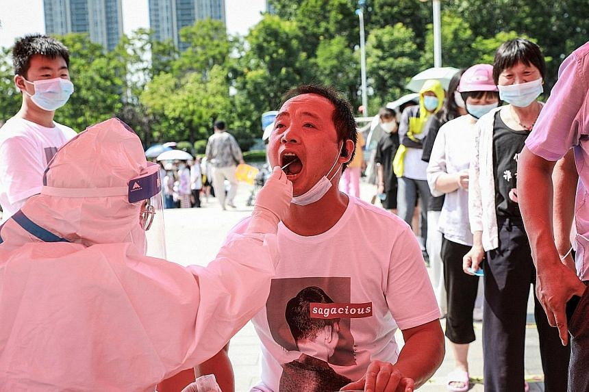 A man receiving nucleic acid testing in Huaian, in Jiangsu province, on Friday, as China raced to contain its worst Covid-19 outbreak in months. The highly contagious Delta variant has already been confirmed in the capital Beijing and four other prov