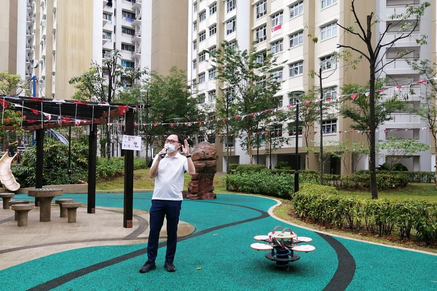 Mr Liang Eng Hwa, the MP for Bukit Panjang, addressing residents using a sound system on the morning of Aug 1.