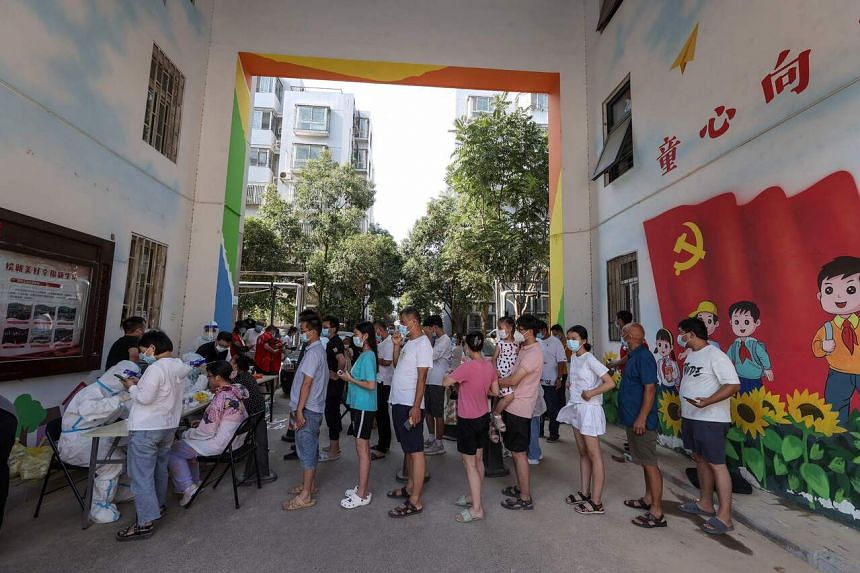 Chinese cities rolled out mass testing of millions of people on Sunday (Aug 1).