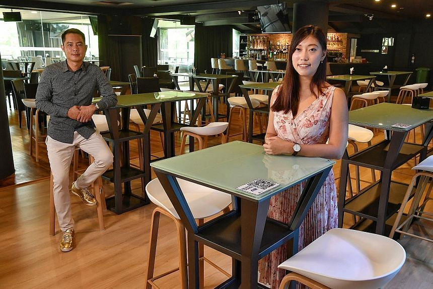 Mr Charlie Teo, director of 8 Degree Lounge, a chain of family-style karaoke outlets, and Ms Jolin Goh, its marketing manager, in their outlet at Orchid Country Club.