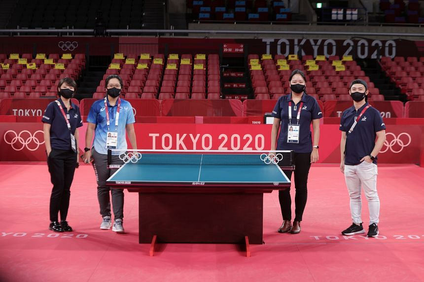 (From left) Tessa Cho, Zena Sim, Kimberly Koh and Seet Cheng Howe are part of the team overseeing the smooth running of the table tennis competition at the Olympics.