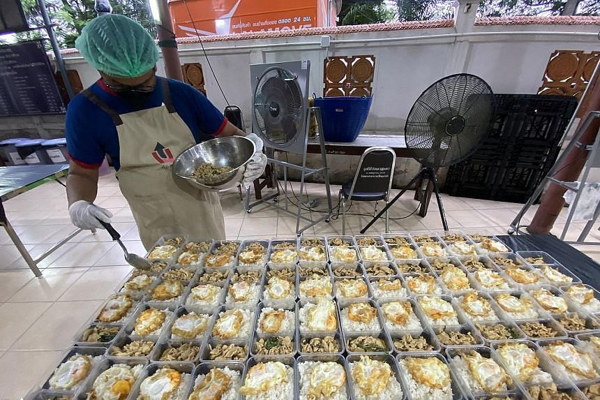 Volunteers at Up for Thai cook meals that are distributed to the less fortunate communities as well as Covid-19 patients and families who are confined to their homes.
