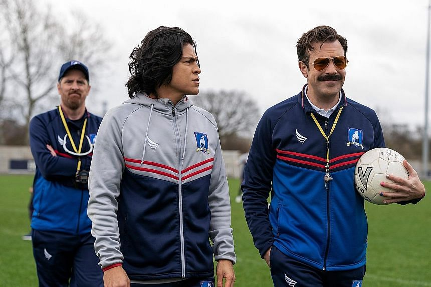 Ted Lasso, about a small-time American football coach who was hired to coach an English Premier League team, stars (from far left) Brendan Hunt, Cristo Fernandez and Jason Sudeikis.