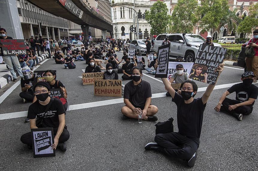 Protesters in Kuala Lumpur demanding the resignation of Malaysian Prime Minister Muhyiddin Yassin and his Cabinet last Saturday, after the government postponed today's special sitting of Parliament. The opposition has decried the adjournment, to an u