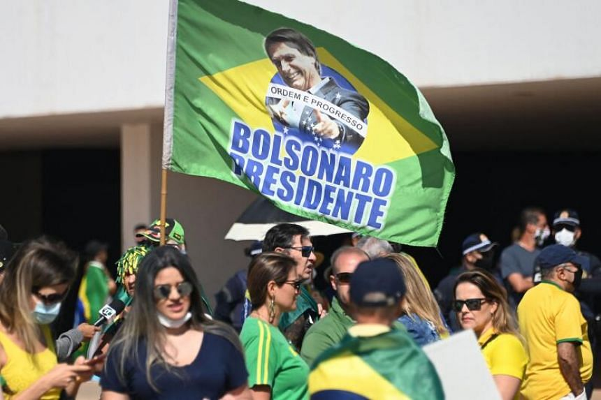 Demonstrators take part in a rally in support of Brazilian President Jair Bolsonaro in Brasilia, Brazil, on Aug 1, 2021.