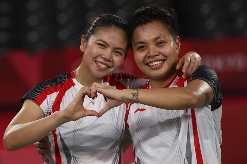 Greysia Polii (left) and Apriyani Rahayu of Indonesia bagged the women's doubles gold medal in badminton at the Tokyo Olympic Games.