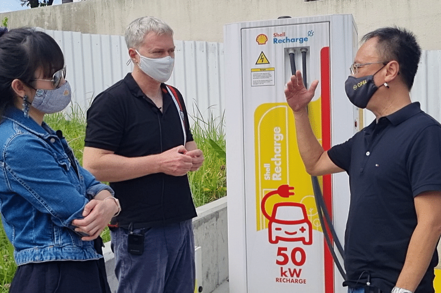 In our Green Pulse Podcast: ST's motoring expert Christopher Tan (right) explains to podcast hosts Audrey Tan and David Fogarty how a public EV charging station is used.