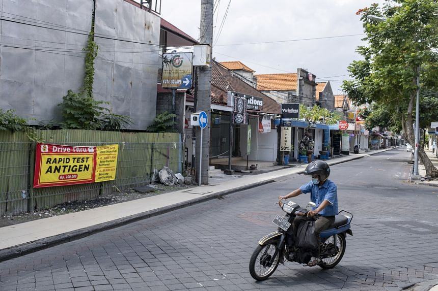 The ongoing lockdown that began July 3 covers parts of Java and Bali (pictured), and 15 other cities and regencies.