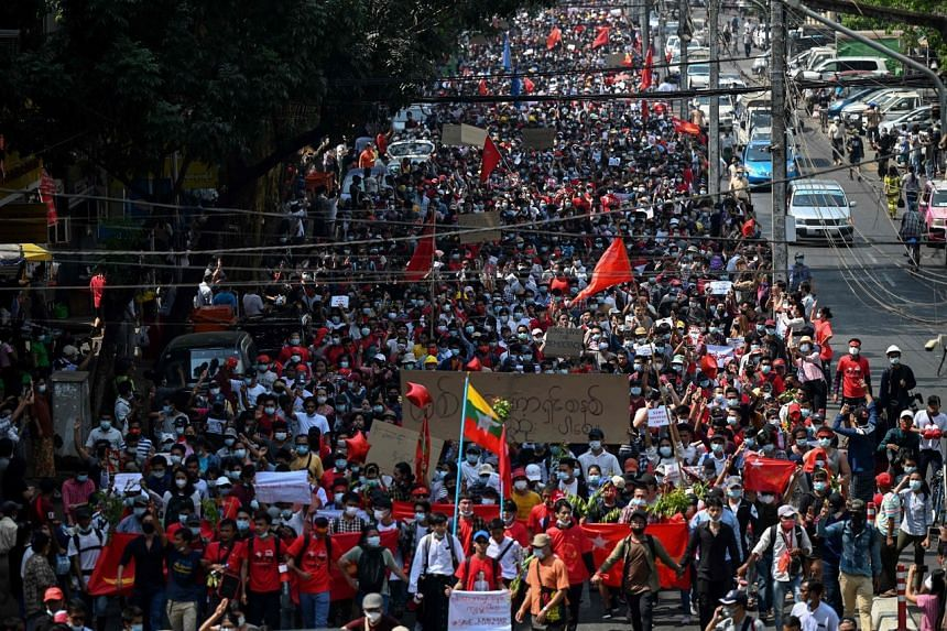 Protesters march during a demonstration against the military coup in Yangon on Feb 7, 2021.