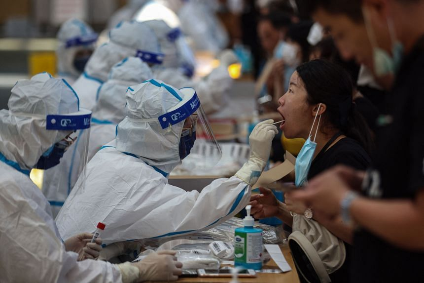 A resident receives nucleic acid test for Covid-19 in Nanjing, in eastern Jiangsu province on July 21, 2021.
