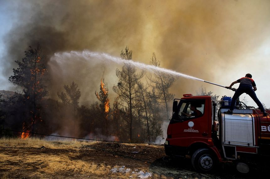A firefighter tries to extinguish a wildfire near Marmaris, Turkey on Aug 1, 2021.