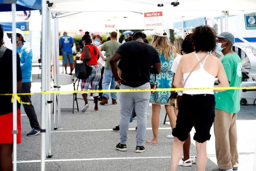 Patients wait in line to get a swab test at a Covid-19 mobile testing site hosted by the Manatee County Florida Department of Health in Palmetto, Florida, US, Aug 2, 2021.