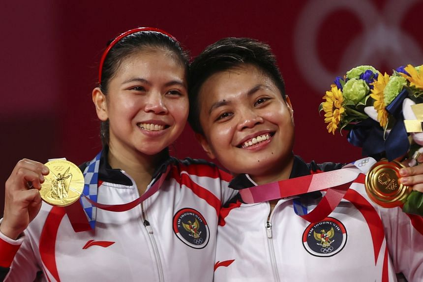 Indonesian gold medallists Greysia Polii (left) and Apriyani Rahayu pose with their medals.