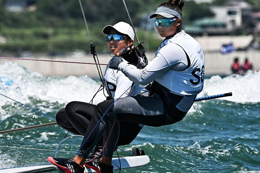 Singaporean sailors Kimberly Lim (left) and Cecilia Low finished 10th out of 21 overall in the 49er FX medal race at the Enoshima Yacht Harbour on Aug 3, 2021.
