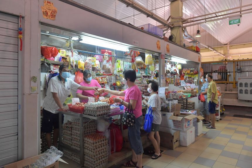 Customers at a stall at Chong Boon Market and Food Centre on its first day of reopening, on Aug 3, 2021.
