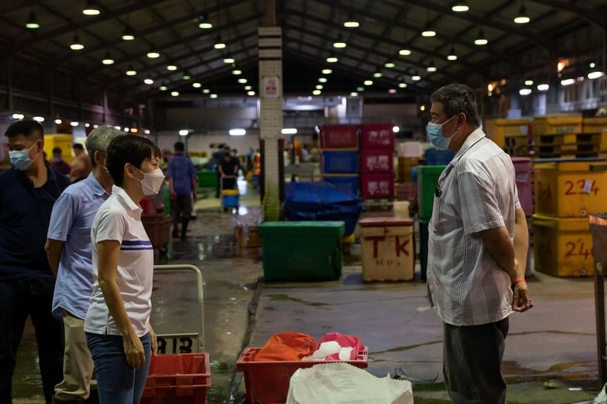 Ms Grace Fu (left) said tenants of the port were progressively opening their stalls and adapting to the enhanced safe management measures.