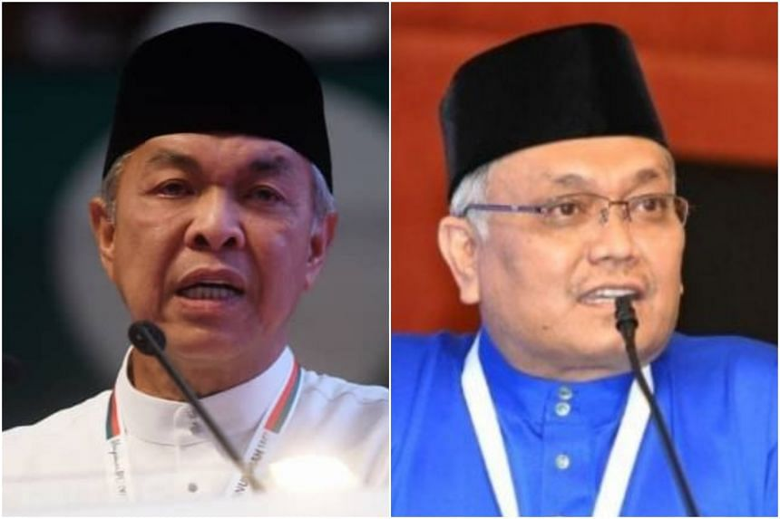 Umno president Ahmad Zahid Hamidi (left) and Malaysia's Energy and Natural Resources Minister Shamsul Anuar Nasarah, who is quitting the Cabinet.
