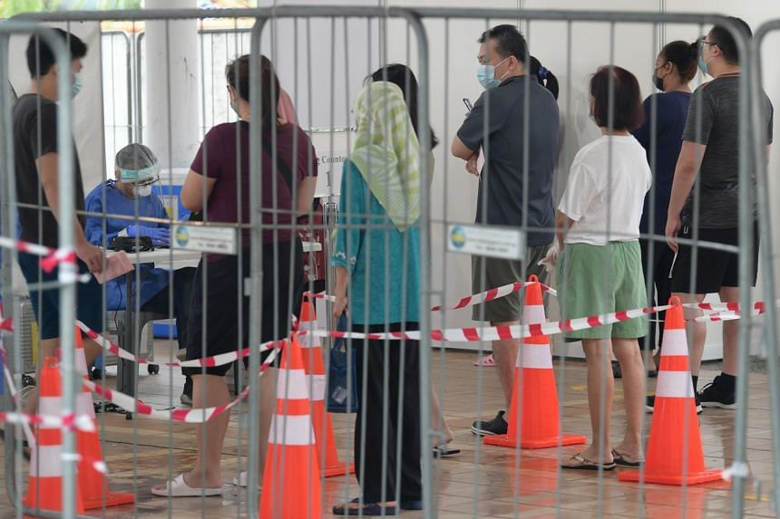 Residents of Block 510 West Coast Drive queueing for mandatory Covid-19 testing on Aug 1, 2021.