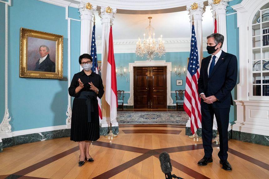 US Secretary of State Antony Blinken listens as Indonesian Foreign Minister Retno Marsudi talks to members of the media in Washington, on Aug 3, 2021.
