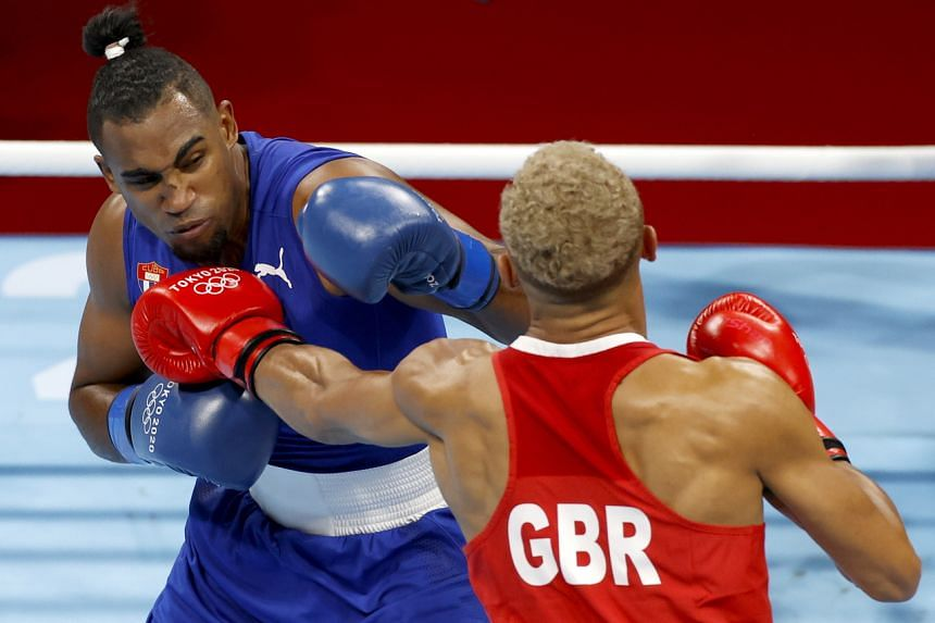 Arlen Lopez (left) kept his cool and put on a skilful display of boxing against Britain's Ben Whittaker.