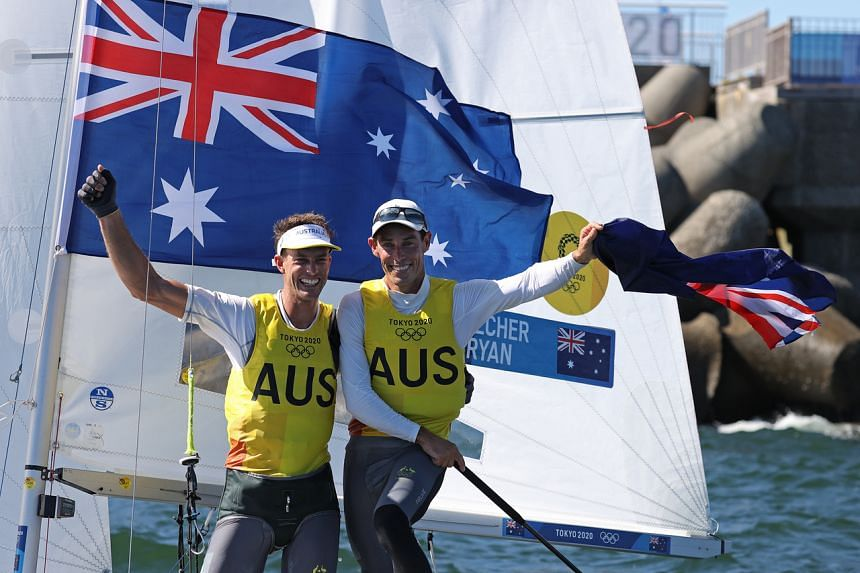 Matthew Belcher and Will Ryan of Australia after winning the men's 470 sailing class at the Tokyo Olympics on Aug 4, 2021.