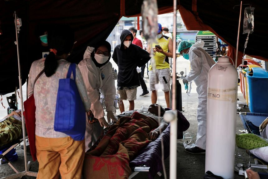 The rapid rise in cases in Sumatra, Kalimantan, Sulawesi and Papua are putting a severe strain on local hospitals and health workers.