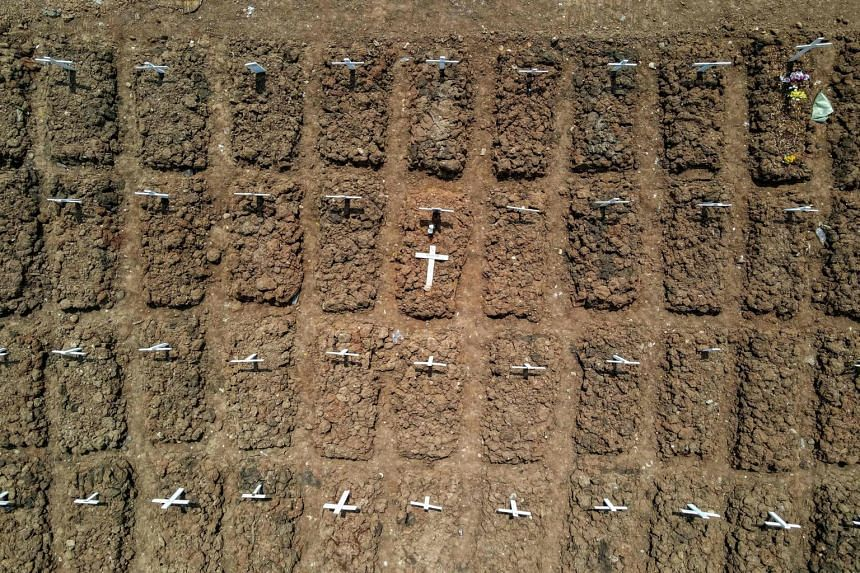 An aerial photo showing the graves of Covid-19 victims at the Rorotan cemetery in Jakarta on Aug 4, 2021.