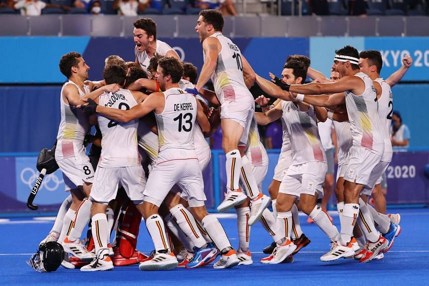 Belgium players celebrate after winning their penalty shoot-out.
