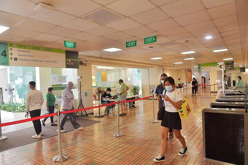 At Singapore General Hospital yesterday, The Straits Times observed that there were only a few people at the ward registration counters. ST PHOTO: ALPHONSUS CHERN