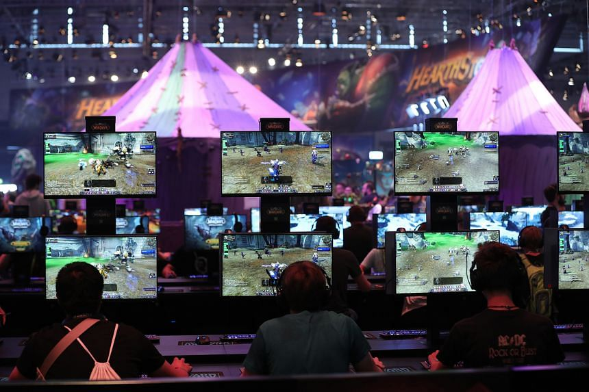 File photo of gamers at the Gamescom gaming industry event in Cologne, Germany in 2018.