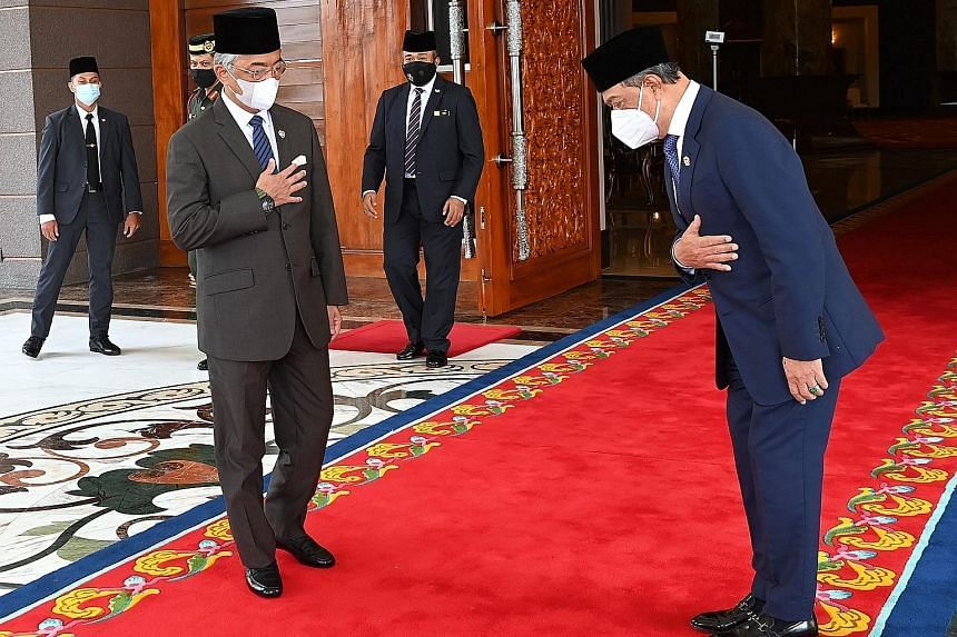 Malaysia's King, Sultan Abdullah Ahmad Shah (left) meeting Prime Minister Muhyiddin Yassin on Aug 4, ahead of a Cabinet session.