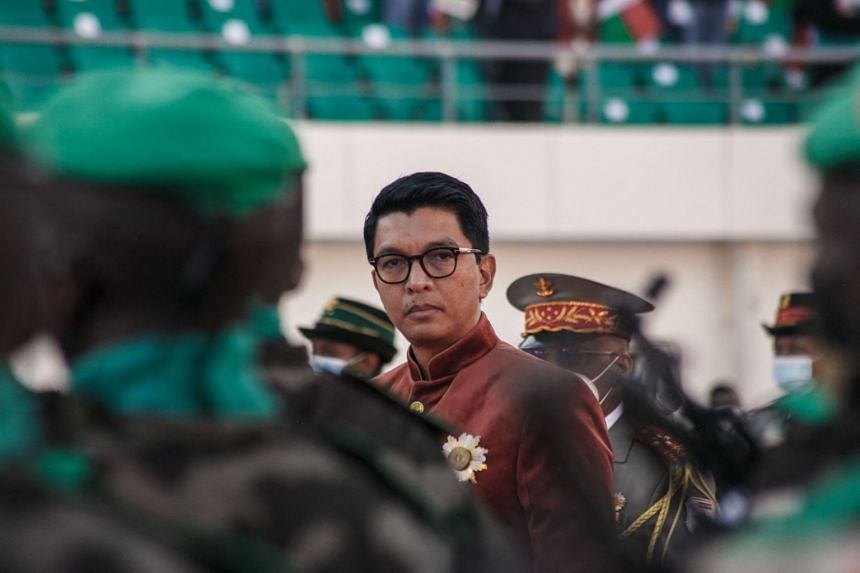 A June 2021 photo shows Madagascar President Andry Rajoelina inspecting troops during Independence Day celebrations in Antananarivo.