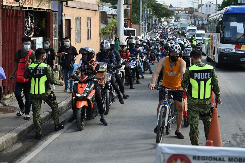 Police checkpoints have been set up around Metro Manila to enforce the movement curbs.