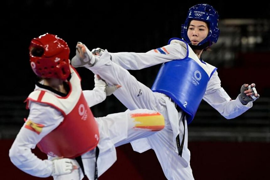 Panipak Wongpattanakit (right) and Spain's Adriana Cerezo Iglesias compete in the taekwondo women's -49kg gold medal bout on July 24, 2021.