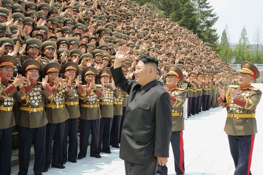 North Korean leader Kim Jong Un takes part in a political event in Pyongyang.in July 2021.