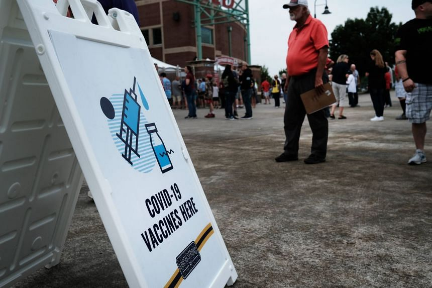 People wait to get vaccinated against Covid-19 at a baseball game on Aug 5, 2021, in Springfield, Missouri.