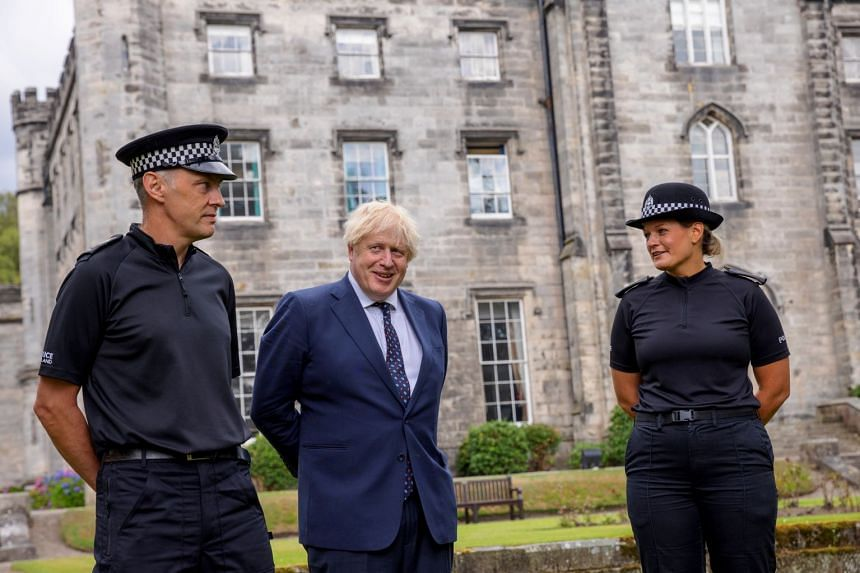 Boris Johnson (centre) visiting the Scottish Police College at Tulliallan near Kincardine, Scotland, on Aug 4, 2021.