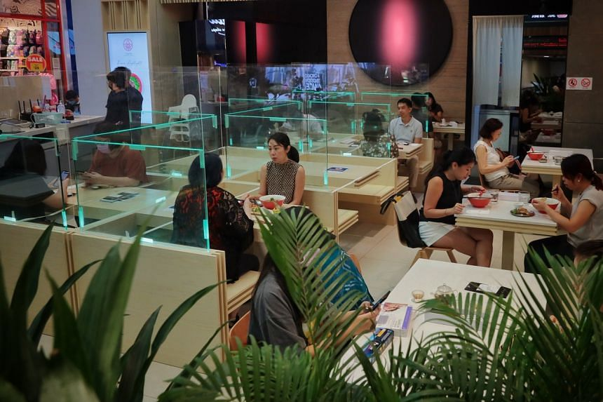Diners in a restaurant at 313@somerset mall ahead of Singapore's phase two (heightened alert) in July.