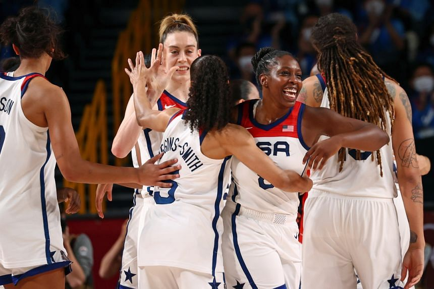 US players celebrate after winning the gold medal basketball match against Japan on Aug 8, 2021.