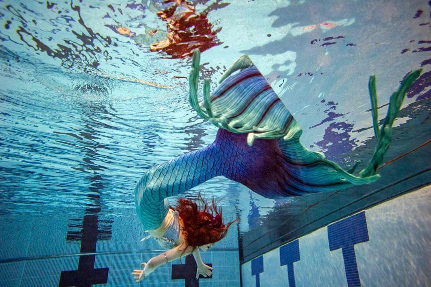 A mermaid poses under water during MerMagic Con at the Freedom Aquatic Center in Manassas, Virginia on Aug 7, 2021.