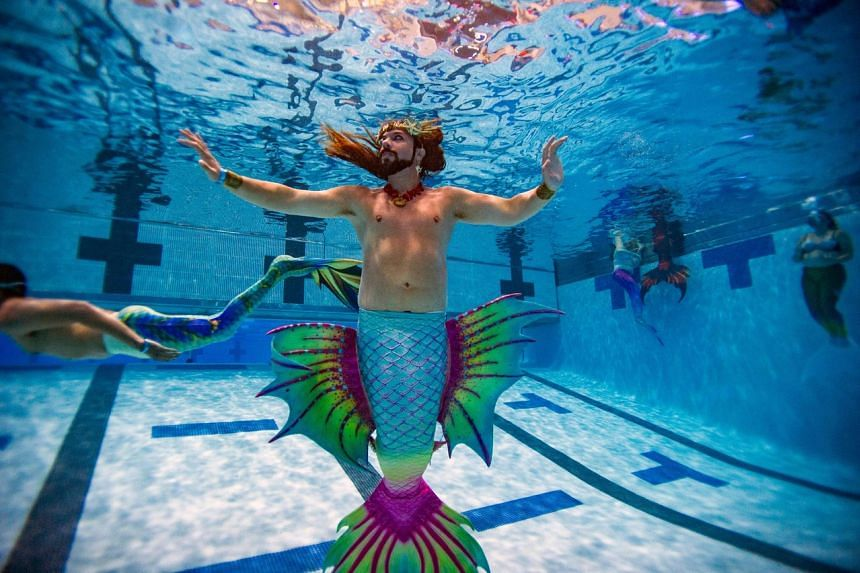A merman poses under water during MerMagic Con at the Freedom Aquatic Center in Manassas, Virginia on Aug 7, 2021.