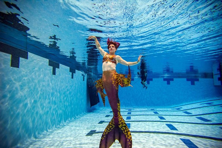 Convention co-founder Morgana Alba poses under water during MerMagic Con on Aug 7, 2021.
