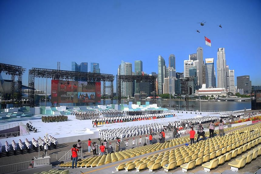 The state flag fly-past yesterday during the National Day ceremonial parade at the Marina Bay floating platform. The pandemic meant there were only 100 spectators, including front-liners, community volunteers and Cabinet ministers.