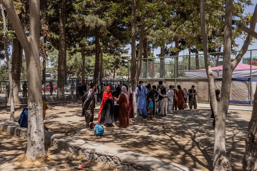Families who fled fighting in northern Afghanistan at a park in Kabul, Afghanistan on Aug 9, 2021.