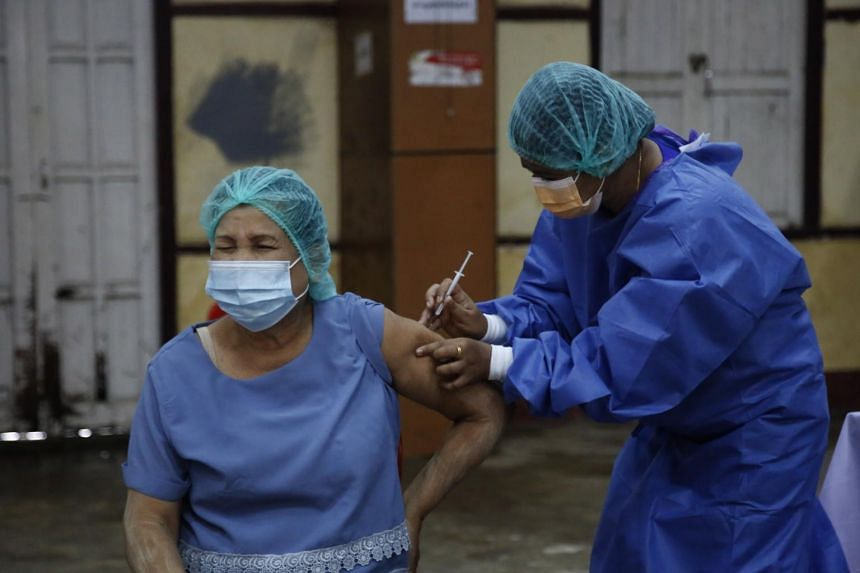 A woman receiving a Sinopharm Covid-19 jab in Sittwe, Rakhine, in western Myanmar, on July 31, 2021.