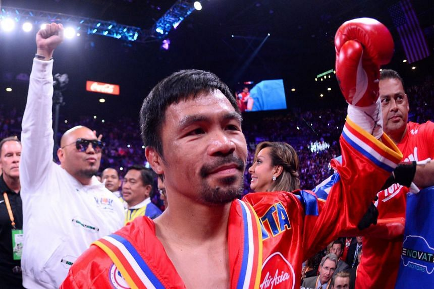 A 2019 photo shows Manny Pacquiao entering the ring to face Keith Thurman for their WBA welterweight championship bout in Las Vegas.