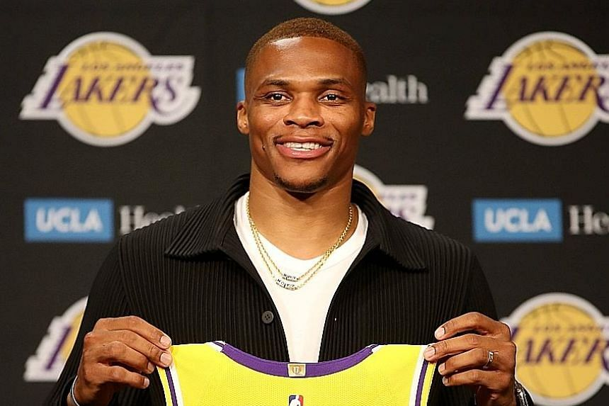Los Angeles Lakers' Russell Westbrook with his jersey during a press conference at Staples Centre on Tuesday. The star guard will link up with LeBron James and Anthony Davis in their bid for an 18th NBA title.