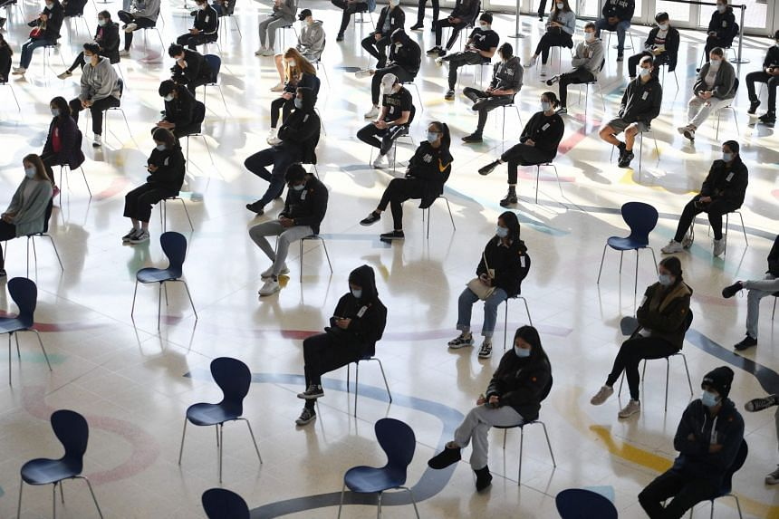 Students wait for their turn to receive their first dose of the Pfizer Covid-19 vaccine in Sydney, on Aug 9, 2021.